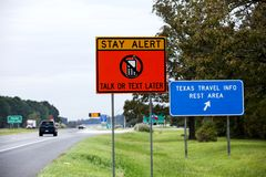 Texas road sign warning about cellphones stock photos