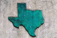 Texas shaped grunge rough textured concrete decoration on stone wall.  stock image
