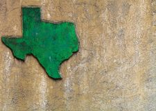 Texas shaped grunge rough textured concrete decoration on stone wall.  royalty free stock image