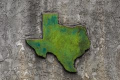 Texas shaped grunge rough textured concrete decoration on stone wall.  royalty free stock images