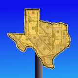 Texas sign with cash. Warning sign in shape of Texas with American dollars Stock Photography
