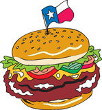 Texas Sized Burger. Texas sized hamburger with lettuce and tomatos Royalty Free Stock Photography