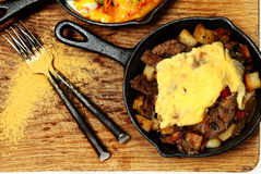Texas Skillet Breakfast with Steak, Potato and Egg Stock Images
