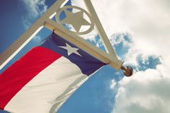 Texas state flag against blue sky and white clouds. State flag of Texas waving in the wind on a sunny day. Blue sky with white clouds background Royalty Free Stock Photos