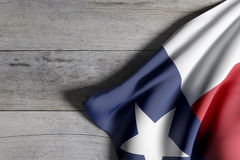 Texas State flag. 3d rendering of a Texas State flag on a wooden surface Royalty Free Stock Images