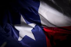 Texas Lone star. The Texas state flag waving in shadow Royalty Free Stock Image