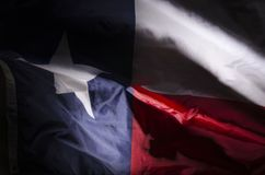 Texas Lone star. The Texas state flag waving in shadow Stock Photos