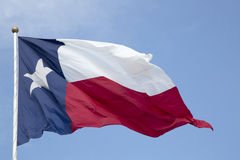 Texas state flag waving in the sky.  stock image
