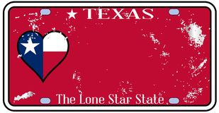 Texas State License Plate With Damage. Texas state license plate in the colors of the state flag wih traffic damage over a white background Royalty Free Stock Images