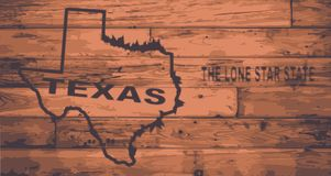 Texas Map Brand. Texas state map brand on wooden boards with map outline and state motto Royalty Free Stock Image