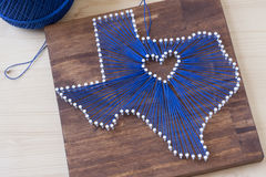 Texas State String Art. String art in the shape of Texas on a wooden background Stock Photo