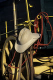 Texas Still Life. A hat propped on a shovel leaning against a wagon, make this a found still life depicting some of the things people may think Texas is known Royalty Free Stock Photos