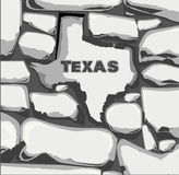 Texas Stone Wall. An outline map of Texas in rock set into a stone wall Stock Image