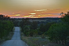 Texas Sunset down a backroad. Beautiful Texas down a dirt backroad captured in Dublin, TX. pink, yellow, blue, purple sunset stock photo