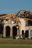 Texas Tornado - Destruction. A tornado destroyed many homes in the Bent Tree neighborhood south of Royse City, Texas on April 3, 2012. The roof of this house Royalty Free Stock Photography