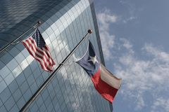 Texas and USA flags. Texas and United States flags in front of an office building Stock Image