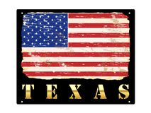 Gold Texas Enamel Sign. Texas word in gold with grungy American flag enamel sign Stock Photography