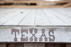 Texas words on wooden plate stock photos