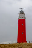Texel lighthouse. Red Texel lighthouse in dunes Royalty Free Stock Photos