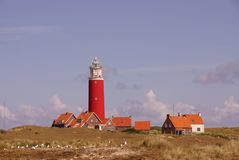 Texel lighthouse. Scenic view of Texel lighthouse with blue sky and cloudscape background, Netherlands Royalty Free Stock Image