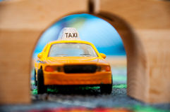 Texi driver , toy car Royalty Free Stock Image