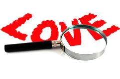 """Text """"LOVE"""" and magnifying glass Royalty Free Stock Photos"""