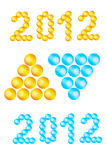 Text 2012 - digits made with balls, heaps of balls. Text 2012 - digits made with balls and heaps of balls - blue and yellow versions Royalty Free Stock Images