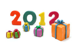 Text 2012 with Gifts. Colored 3D Text 2012 with Various Gifts on White Background Royalty Free Stock Photo