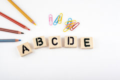 Text: abcde from wooden letterson on white office desk Royalty Free Stock Image