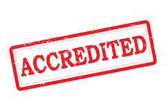 Accredited. Text 'accredited' in red grunge uppercase letters on white inside a red rectangle  making an accreditation stamp on a white background Stock Photography