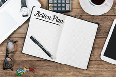 Text action plan on notbook, Office desk with computer technolog Royalty Free Stock Images