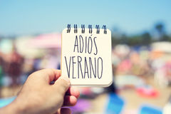 Text adios verano, good bye summer in spanish royalty free stock images