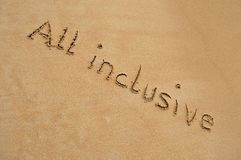 Text All inclusive. The text all inclusive written in the sand at the beach Stock Photos