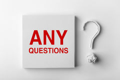 Text Any Questions and Question Mark. Red text Any Questions and paper question mark with white background stock image
