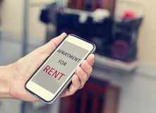 Text apartment for rent in a smartphone Royalty Free Stock Photo