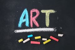 The text of the art is drawn with colorful chalk on a chalkboard. The text of the art is drawn with colorful chalk on a chalkboard stock images