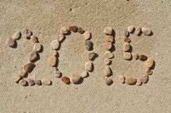 Text 2015 auf dem Strandsand Stockfotografie