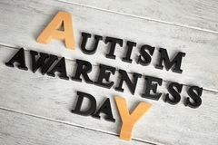 Text AUTISM AWARENESS DAY. On wooden background Royalty Free Stock Photos