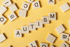 Text of AUTISM on wood cubes. Wooden abc