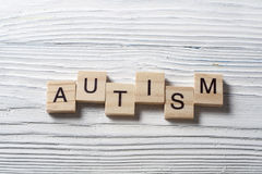 Text of AUTISM on wood cubes. Wooden abc. Royalty Free Stock Image