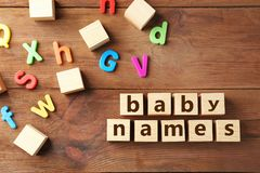 Text BABY NAMES o. N wooden background Stock Photo