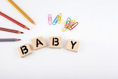 Text: Baby from wooden letterson on white office desk Stock Photos