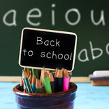 Text back to school on a blackboard Royalty Free Stock Photos