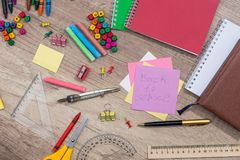 Text back to school with school supplies. On desk Royalty Free Stock Photography