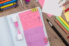 Text back to school with school supplies. On desk Royalty Free Stock Images