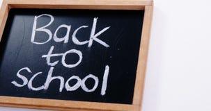 Text back to school written on a chalkboard stock video