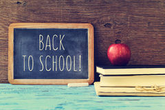 Text back to school written on a chalkboard, cross processed Royalty Free Stock Photo