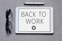 Text back to work in a tablet computer Royalty Free Stock Photo