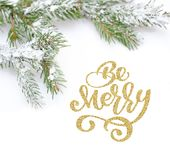 Text Be Merry of Christmas tree in snow, on white background. Flat lay, top view photo mockup.  Royalty Free Stock Photo