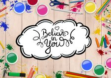 Text believe in you with various watercolor and pencils on wooden background Stock Image